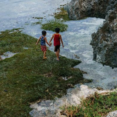 Siblings looking for sea urchins – Bohol